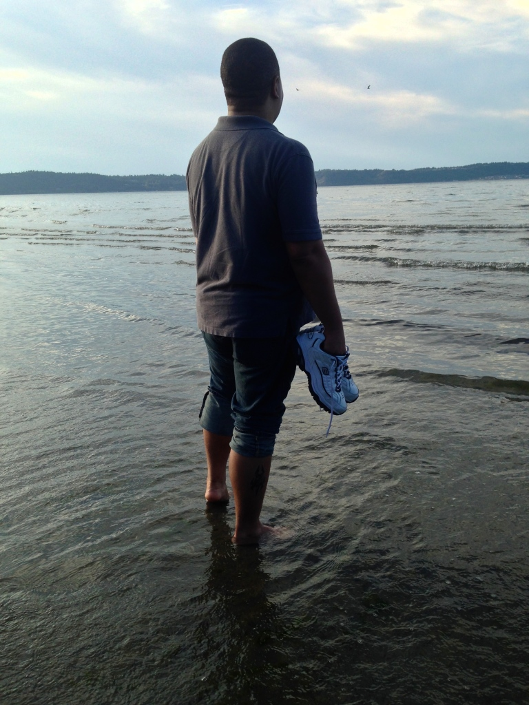 Tim, sinking his toes into the sands of the Sound.