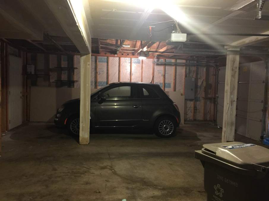 Very little car in a normal-sized garage bay.