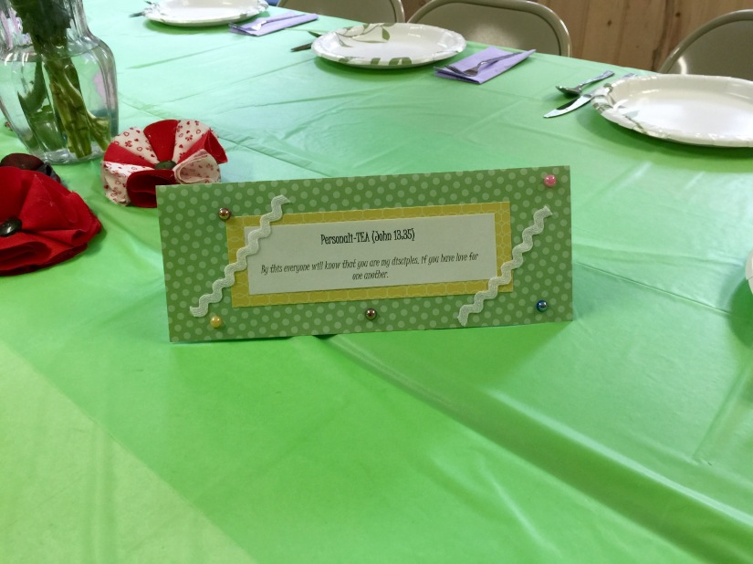 Table decorations included bible verse tents and fabric flowers (made by me.)