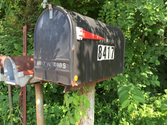 The mailbox, which is the only sign that we ever lived there.