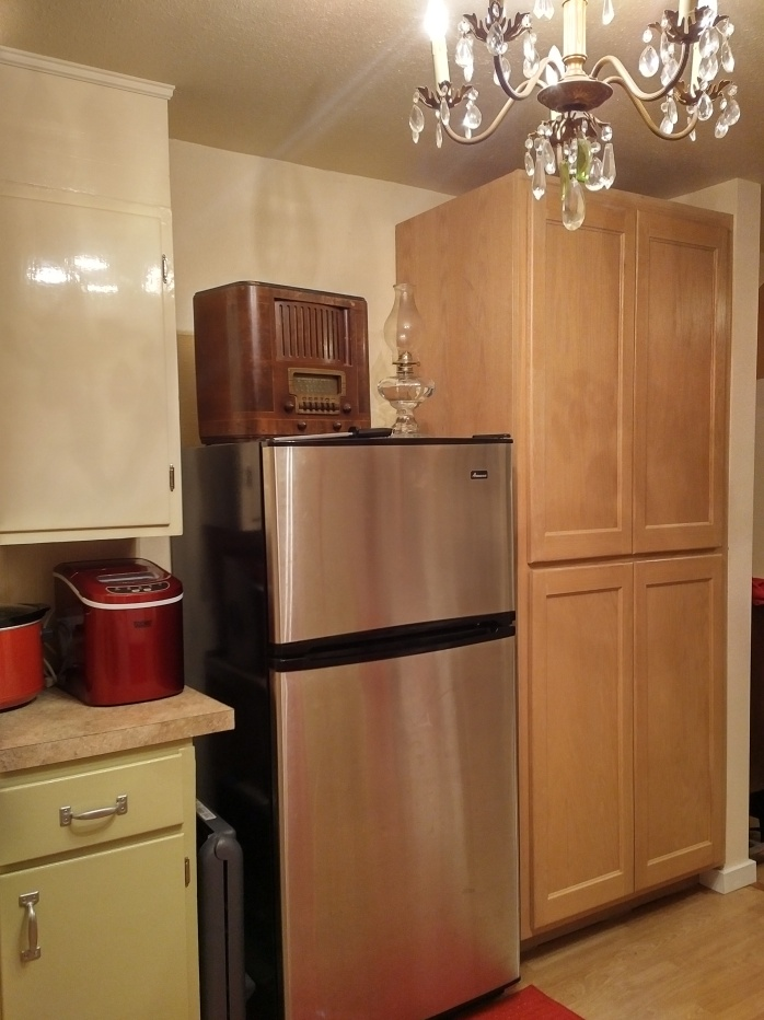 Fridge with a few vintage touches on top and my beautiful pantry with slide-out shelves.