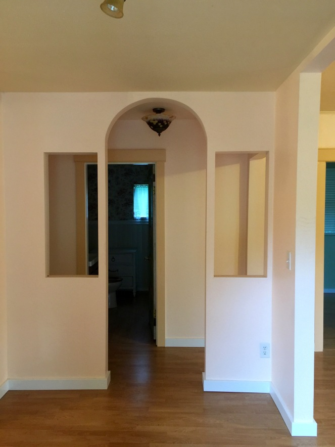 I love these cut-outs. These are in the dining room and the guest bathroom is directly ahead. Office to the left, guest bedroom to the right.