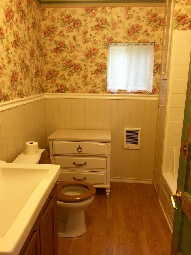 This is the guest bathroom, with its vintage wallpaper and beautiful bead board.