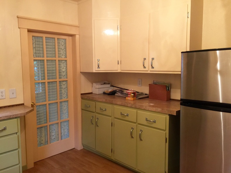 The opposite wall of the kitchen, with the door to the utility room and all of my cabinets.